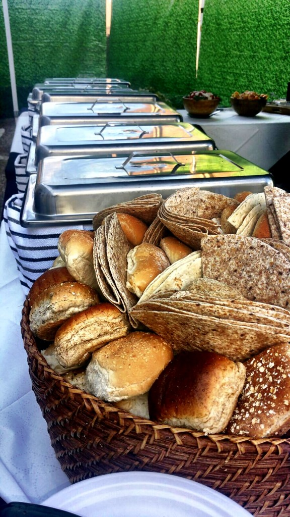 Fresh Bread Rolls And Serving Dishes